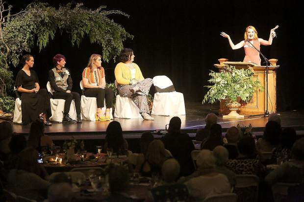 Friendship Club and soon to be Bitney College Prep graduate Hailey Swain addresses the dinner crowd gathered during the club's 2019 Graduation Gala while fellow graduates Scarlett Jones (from left) Guage Johnson, Dejah Thurman, and Hannah English await to give their speeches.