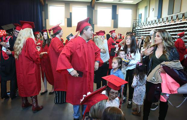 Friends and family greet the recent Sierra College graduates during a reception following Thursday's graduation ceremony.