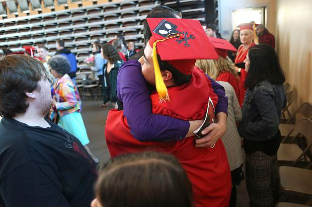 Friends and family embrace the recent Sierra College graduates during a reception following Thursday's graduation ceremony.