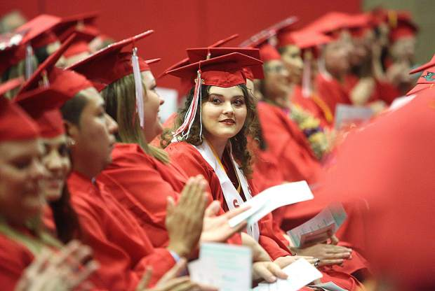 Sierra College Nevada County Campus graduate Lacey Lee Krutiak smiles at her fellow graduates during Thursday's commencement ceremony held in the college's gym.