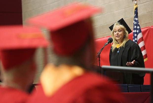 Sierra College professor Carol Jean Cox gives an energetic speech to the Nevada County Campus graduates.