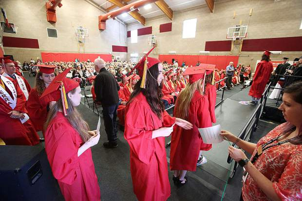 Sierra College Nevada County Campus students line up to receive their diplomas during Thursday's commencement ceremony.