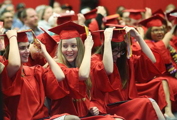 The Sierra College Nevada County Campus students move their tassels from the right to left, symbolizing their graduation during Thursday's commencement ceremony.