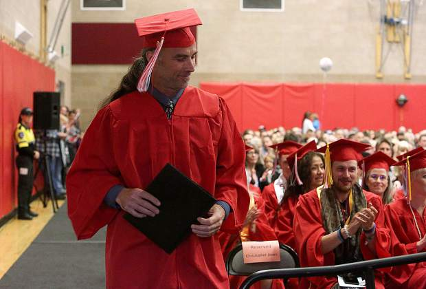 Christopher Jones receives applause as he prepares to make the student address for the Sierra College Nevada County Campus graduates.
