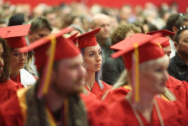 Graduates listen to the speeches given by Sierra College's faculty during Thursday's commencement ceremony.