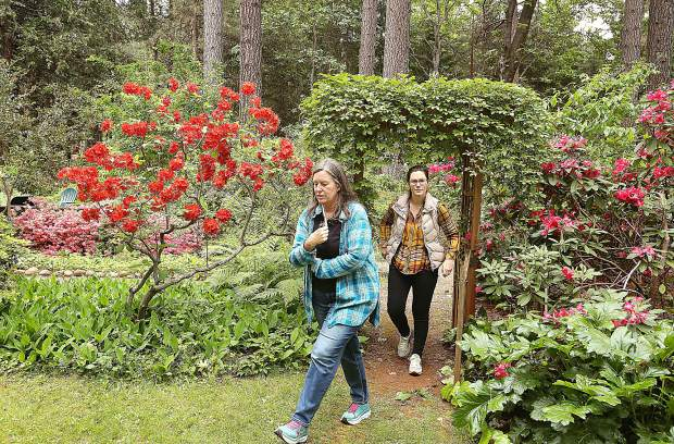 Emily Baumstinger and her mother walk through the Ruland garden Saturday during the 26th annual Spring Garden Tour.