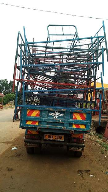 Newly made bunk beds arrive at the  Siloam Mountain Junior School in central Uganda.