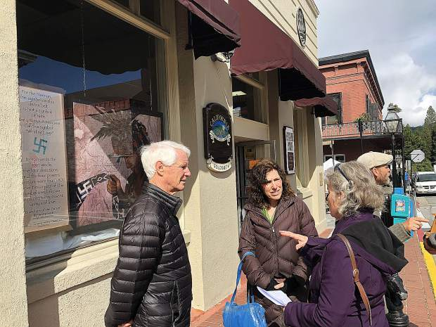 Jenny Hale explains her work to Joanne Hill, Sierra Streams executive director and Alan Barlow, Nevada County resident.