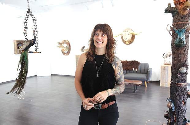 Hollie Dilley stands among her artwork that is part sculpture, part taxidermy, and 100 percent imagination currently on display at the Chambers Project in Nevada City.