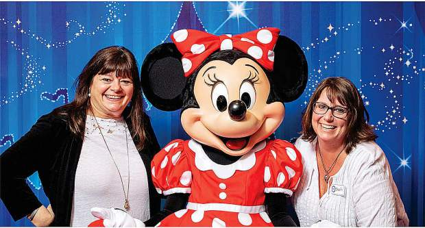 Just back from Disneyland, newspaper columnist Hollie Grimaldi-Flores and professional event organizer Shanin Ybarrando reluctantly put away their Mickey Mouse ears.