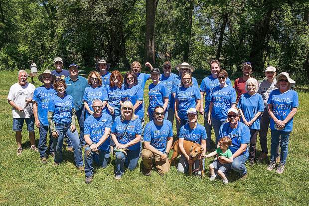 Employees and clients of Meyers Investment Group of Baird & Co. weeded, planted, spread bark, and completed other beautification projects at Western Gateway Park.