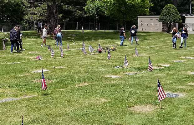 For more than a decade, Nevada Union High School FFA members have been honoring military veterans who have passed away by placing American flags at the veterans' headstones.