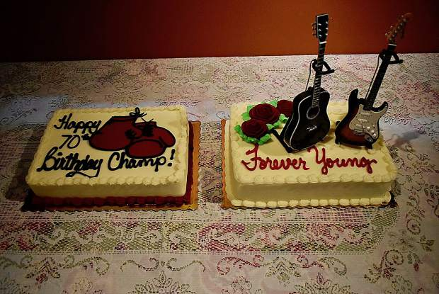 Ken Bigham celebrated his 70th birthday with two special cakes: one honored his victories in the boxing ring, and a second cake was a tribute to his musical prowess.