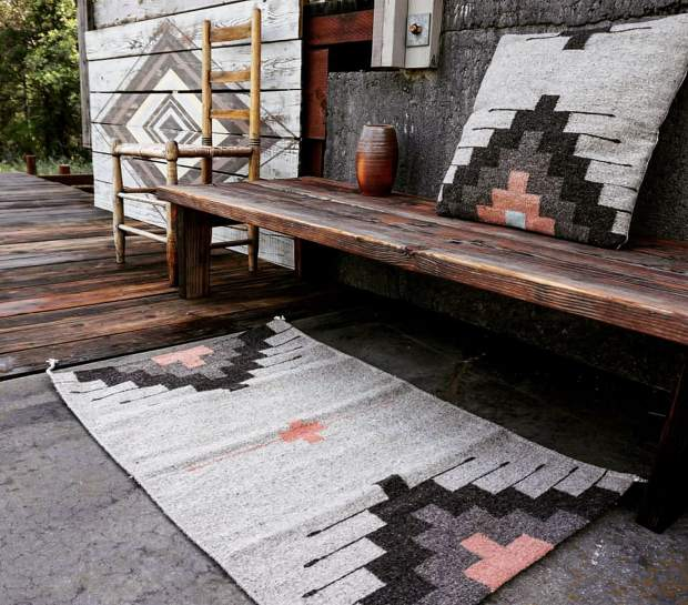 Handwoven rugs and pillows, as well as handpainted reclaimed wood are part of the HŌM collection by Leif Wold and Danielle Rubio.