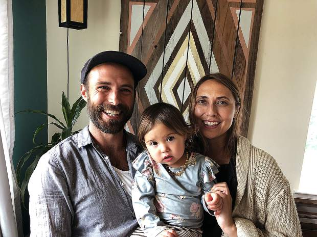 Leif Wold, left, Danielle Rubio and their daughter Voa have a home studio in Rough and Ready for their business HŌM.