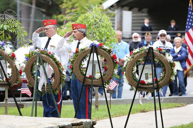 Members of the local Marine Corps League salute a wreath laid in honor of those service members from the Marines that lost their lives for the country during Nevada City's Memorial Day ceremony at Pioneer Park's Memorial Grove.