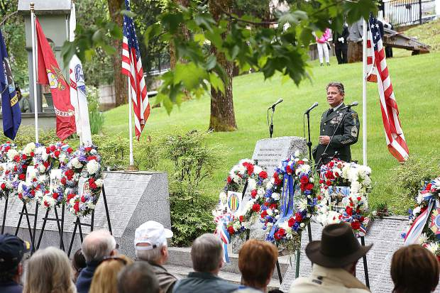 Grass Valley Memorial Day ceremony keynote speaker Brian Comte addresses the crowd of veterans, family, friends, and fellow warriors as he talks about the difference between those who fight for the country, and those war mongers who profit off of conflict.