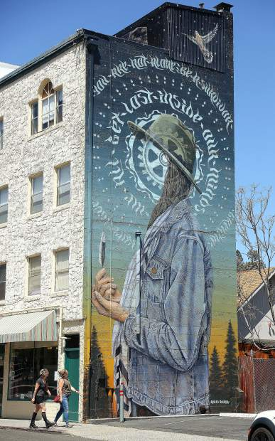 A pair of pedestrians take time to notice downtown Grass Valley's newest mural titled