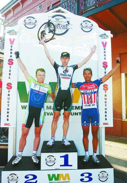 Scott Moninger, center, raises the trophy after winning the 2006 Nevada City Classic. At left is 2006 runner-up Gordon McCauley, left, and Antonio Cruz, who finished third.