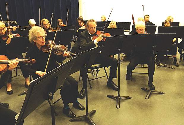 Violinists perform for the OLLI Orchestra.