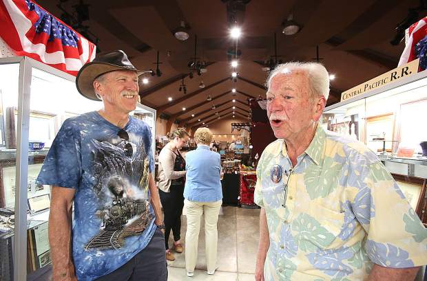 Tom Martin (right) was happy to show off his collection of Transcontinental Railroad memorabilia.