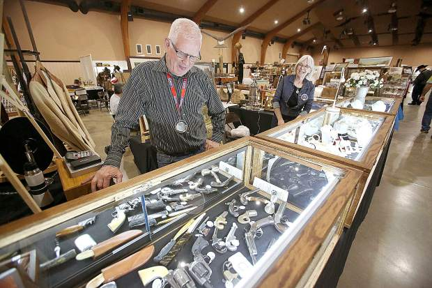 Canby Oregon's Dusty Schmidt stands behind one of his displays full of historic and antique guns and knives from the old west during The Grass Valley Old West Show May 10th and 11th at the Nevada County Fairgrounds.