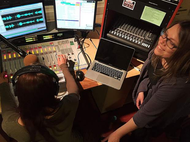 New KVMR 89.5 FM General Manager Ali Lightfoot (right) trains a