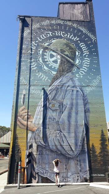 Audrey Higgins admires the new mural in downtown Grass Valley.