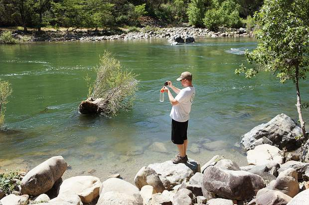 Noah Halton imaging the remarkable hue of the verdant and snow melt-swollen South Yuba River at Bridgeport.