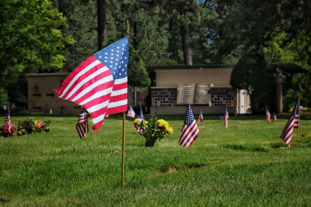 The setting of the flags at Hooper and Weaver Mortuary In Nevada City in honor of Memorial Day Weekend.