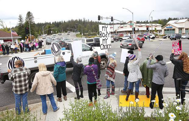 About 80 to 100 protesters gathered on the four corners of Brunswick Road and Sutton Way during Tuesday afternoon's pro-choice rally.