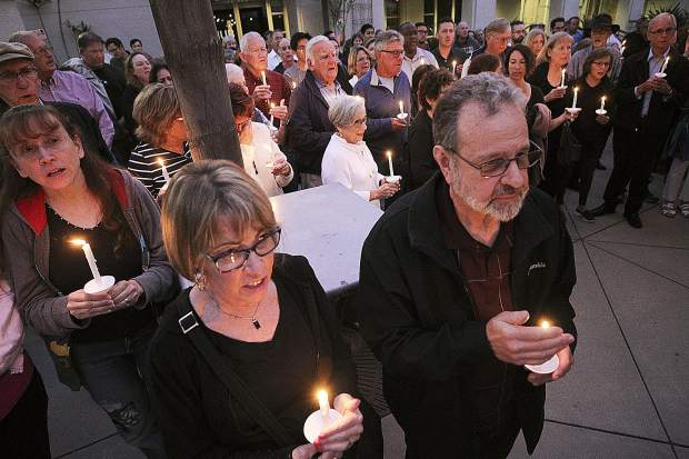 People from the community join members of the Rancho Bernardo Community Presbyterian Church in a candlelight vigil for the Chabad of Poway synagogue. On Friday, the Chabad of Grass Valley will lead a Unity Shabbat service Friday free and open to non-members at 7 p.m.