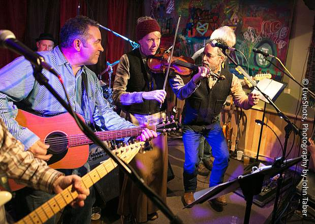 Saul Rayo, second from right, will perform a few songs with his band during Friday night's benefit.