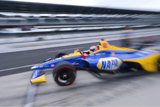 Alexander Rossi drives out of the pit area during practice for the Indianapolis 500 IndyCar auto race at Indianapolis Motor Speedway, Friday in Indianapolis.