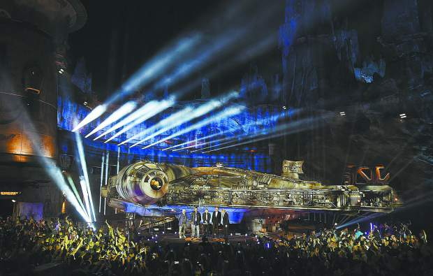 The Millennium Falcon starship is pictured onstage during a dedication ceremony for the new Star Wars: Galaxy's Edge attraction at Disneyland Park, Wednesday, May 29, 2019, in Anaheim, Calif. From left,