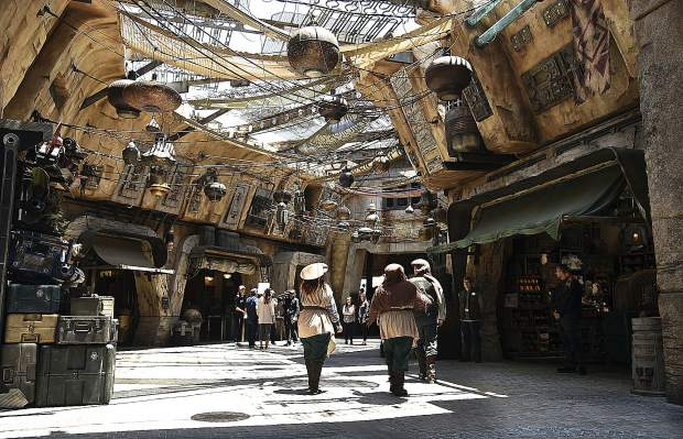 Characters stroll through the marketplace at the Black Spire Outpost during the Star Wars: Galaxy's Edge Media Preview at Disneyland Park, Wednesday, May 29, 2019, in Anaheim, Calif. (Photo by Chris Pizzello/Invision/AP)
