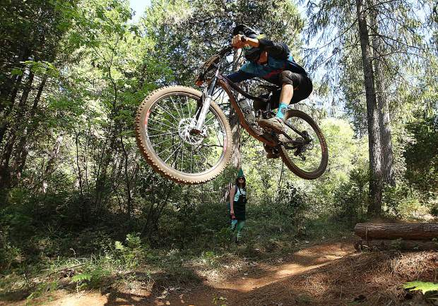 A rider takes to the air from a jump on one of TDS Enduro's routes.