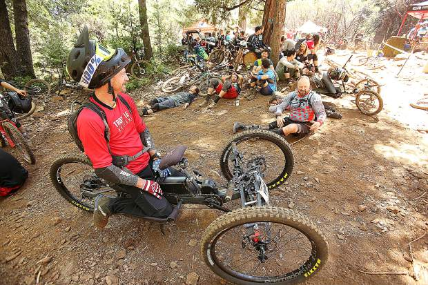 Semper Fi hand bike rider Jeremy McGhee talks to fellow Semper Fi riders as they await a ride on TDS Enduro routes Saturday in Grass Valley. The invitation-only event has become an attraction to highly-skilled mountain bikers.
