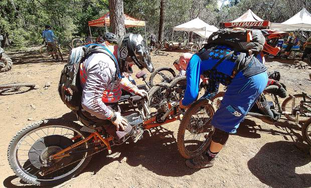 Semper Fi riders shed their prosthetic limbs as they strap into their bikes and ready for the downhill rides of TDS Enduro in Grass Valley.