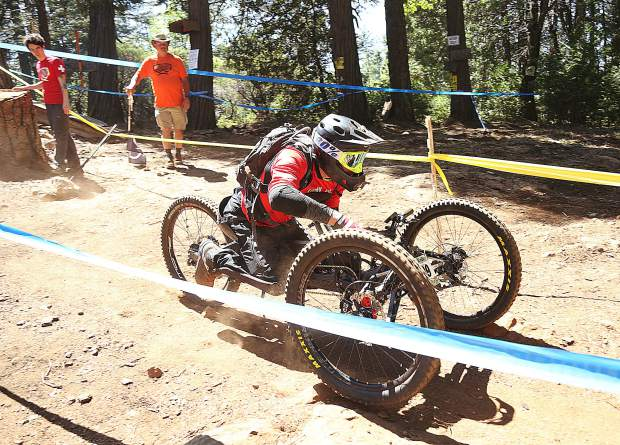 Team Semper Fi rider Jeremy McGhee rides along TDS Enduro routes in his adaptive hand bike.