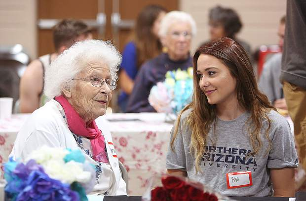 Eskaton resident Thelma Jackson sits next to Sierra Academy of Expeditionary Learning student Roo Yarnell during Tuesday's closing ceremony honoring their seniors connecting project.