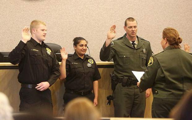 Tyler Droivold, Harleen Sangha, and Brandon Lampe are all sworn in by Nevada County Sheriff Shannan Moon during Wednesday morning's badge pinning ceremony. Droivold and Sangha join the Sheriff's Office as correctional officers, while Lampe re-joins the patrol division.