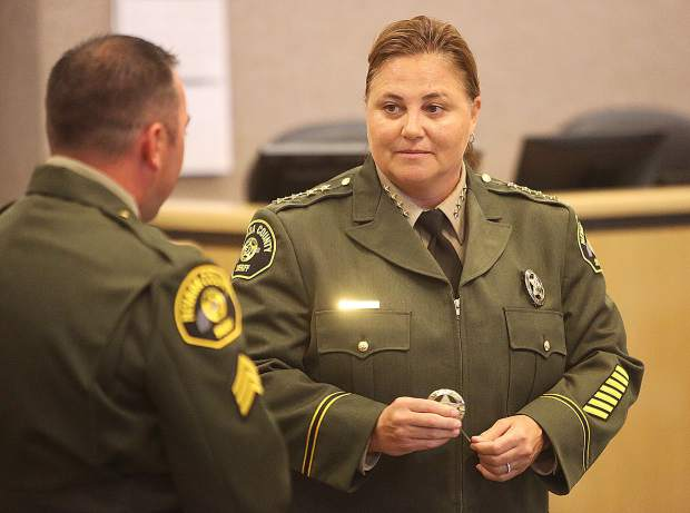 Nevada County Sheriff Shannan Moon prepares to pin a badge during Wednesday's ceremony.