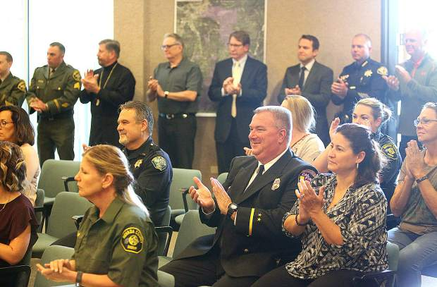 Attendees of Wednesday's badge-pinning ceremony applaud the additions and promotions within the Nevada County Sheriff's Office.