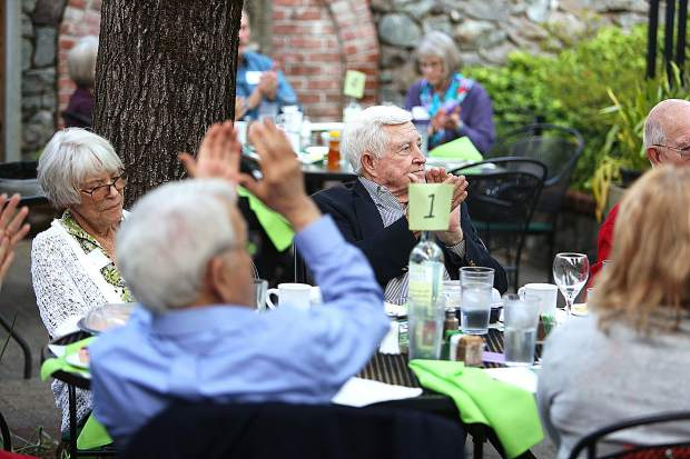 Members of the Sierra Roots Community Builder Dinner 2019 applaud the recipients of the awards Thursday evening at Toffanelli's.