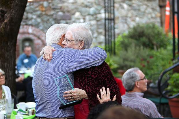Janice O'Brien hugs her husband Jim, who has been there to help her in her quest to help better the conditions for area homeless.