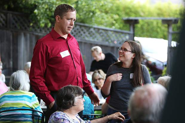 Nevada City First Baptist Church Pastor Roland Meyer and his wife Andrea greet those at the tables during the Sierra Roots Community Builder Dinner 2019. Pastor Meyer was awarded the Community Collaborator Award during the dinner.