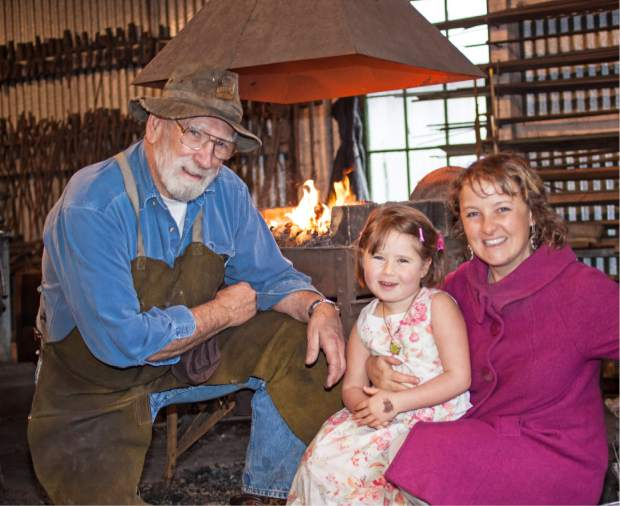 """Smithy Bill Blount explains the significance of the """"prairie-diamond"""" ring to Mother's Day visitors during the 2014 Springtime at the Mine event."""