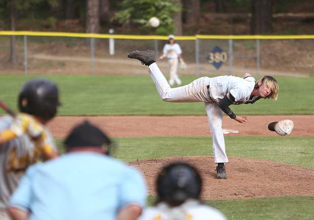 Nevada Union High School's Bennet King (17) loses his hat as he fires a pitch towards a Yuba City Honkers batter during a game earlier this month.