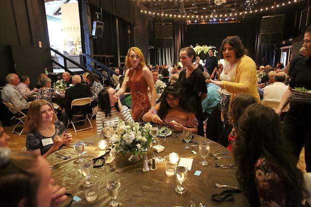 Friendship Club grads walk among the tables and thank the attendees of the 2019 graduation gala earlier this month at the Miners Foundry.